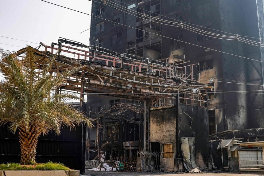 The aftermath of a fire at a Chinese-owned garment factory in the Hlaing Tharyar industry zone in Yangon, on March 21, 2021.