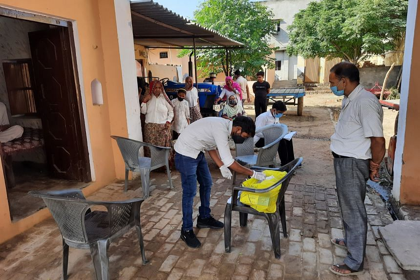 A team from the Uttar Pradesh state government preparing to test locals for Covid-19 in Khalidpur village, Meerut district.