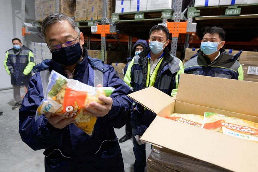 Minister for Trade and Industry Gan Kim Yong (left) expressed appreciation to logistics professionals and supermarket staff for their hard work.