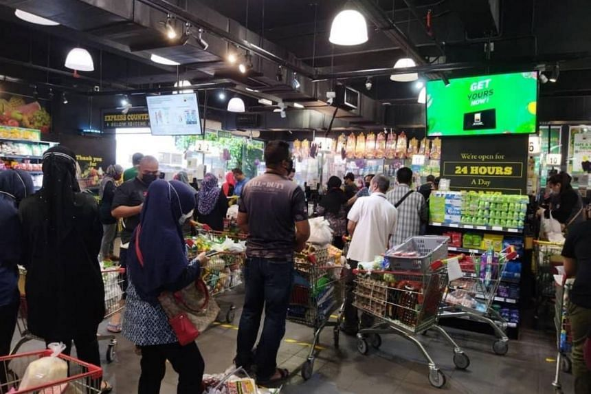 Social media users reported long queues of people grocery shopping.