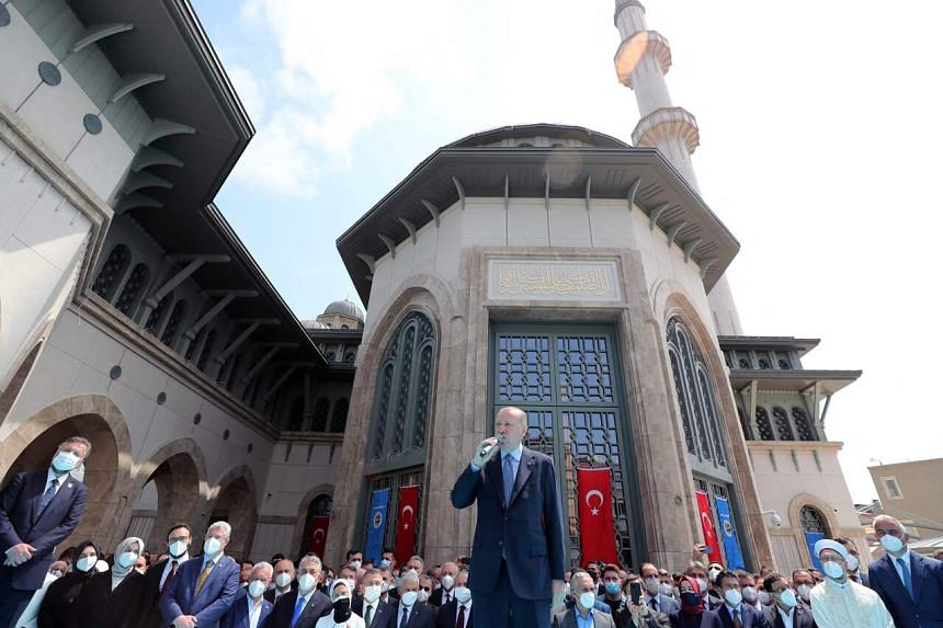 Turkish President Recep Tayyip Erdogan (centre) during the opening ceremony of Taksim Mosque in Istanbul on May 28, 2021.