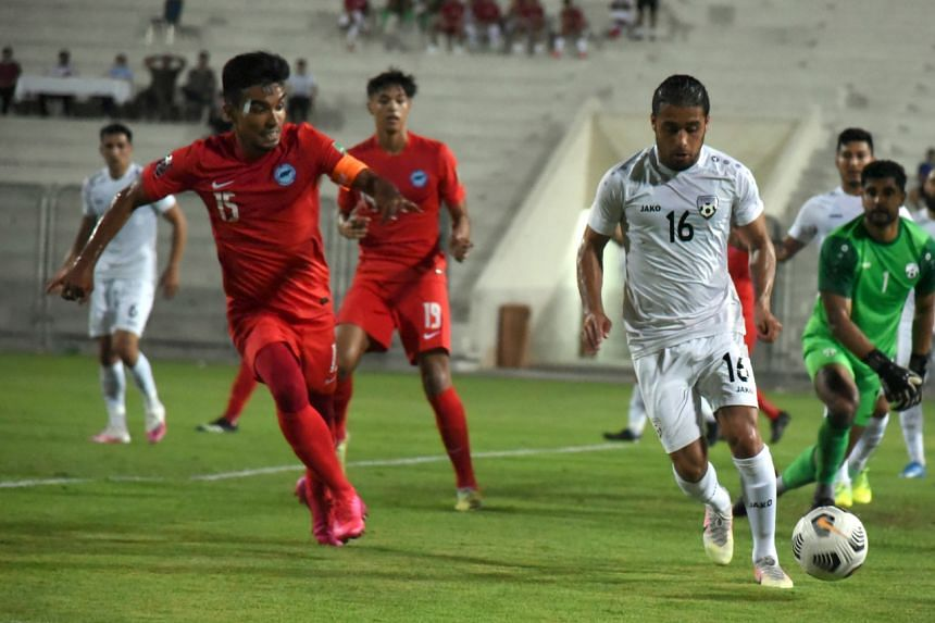 Yasir Hanapi (left) captained the Singapore team in the match.