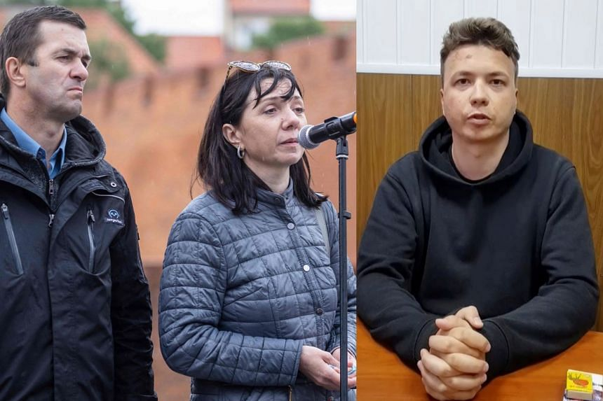 Natalia and Dmitry Protasevich, the parents of Belarusian journalist Roman Protasevich, speak at a demonstration against his detention in Warsaw, Poland.