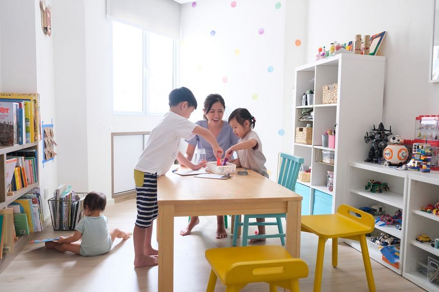 Madam Fynn Sor teaches parents how to set up learning spaces at home.