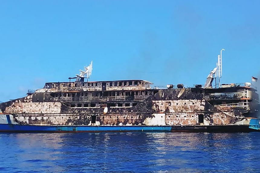 Smoke billowing from the KM Karya Indah passenger ferry in Indonesia's Molucca Sea, after a fire broke out on Saturday .