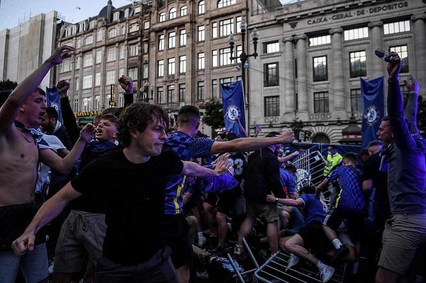 Many English fans, like these overjoyed Blues supporters, were mask-less and failed to observe social distancing rules while in Porto.
