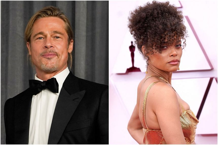 Actor Brad Pitt and singer-actress Andra Day were spotted exchanging phone numbers backstage at the Oscars.