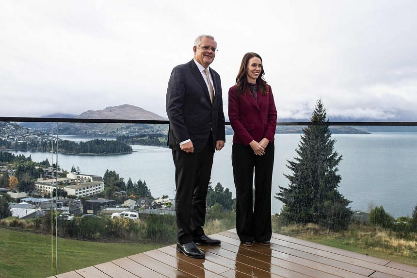Australia's Prime Minister Scott Morrison with New Zealand's Prime Minister Jacinda Ardern in Queenstown on May 31, 2021.