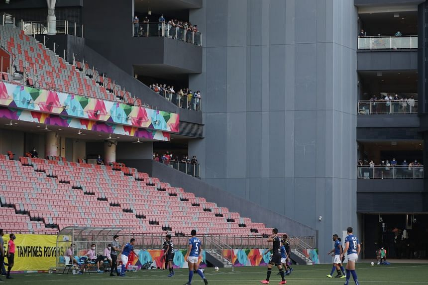 A handful of fans watching the Singapore Premier League game at Our Tampines Hub on Oct 17, 2020.