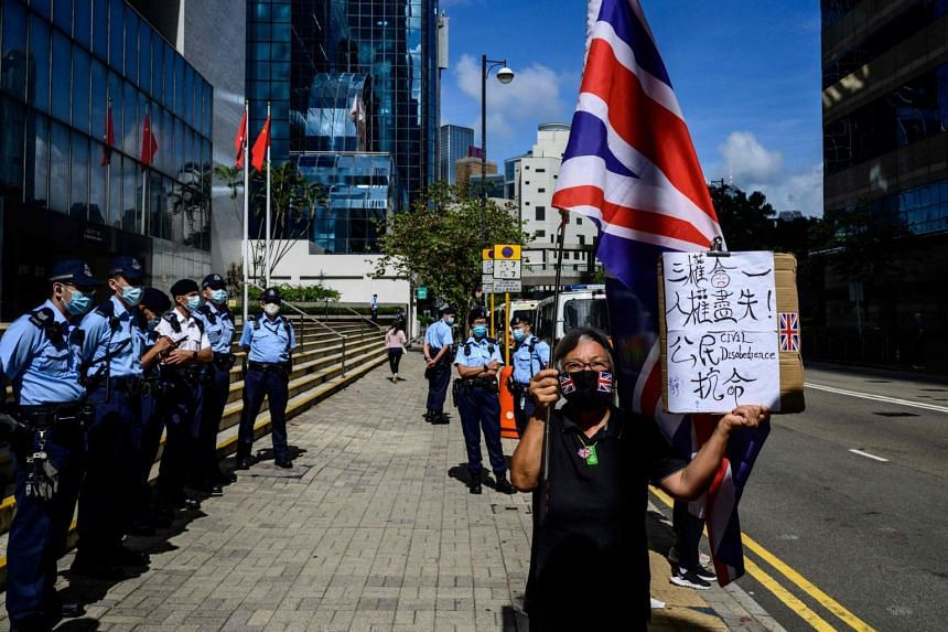 Alexandra Wong, an activist known as Grandma Wong, holds a British Union Jack flag outside the District Court in Hong Kong on May 28, 2021.