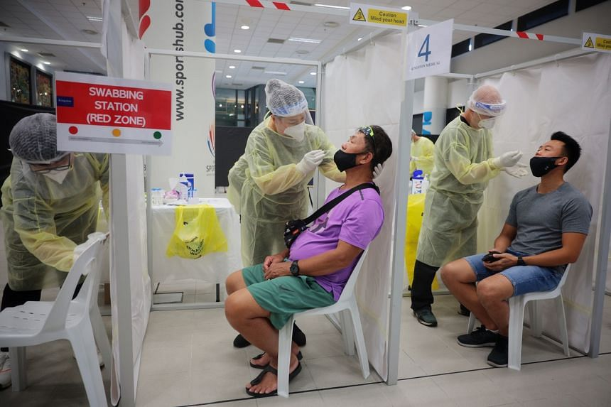 Fans being swabbed for the antigen rapid test before attending the Singapore Tennis Open event in February.