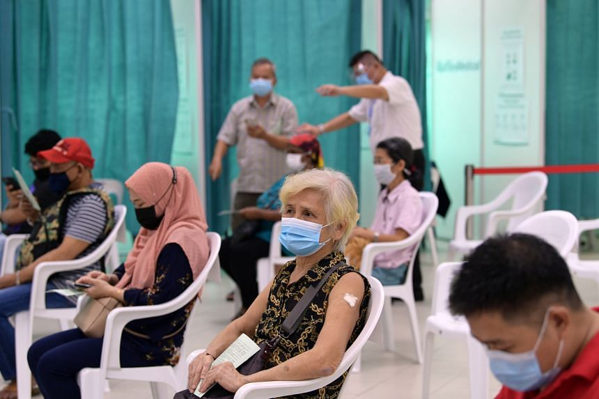 People waiting in the observation area at the Covid-19 vaccination centre at Marsiling Community Club after receiving their jabs on June 1, 2021.