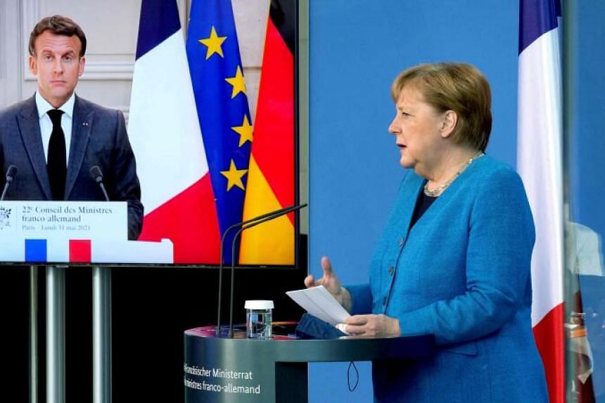 French President Emmanuel Macron and German Chancellor Angela Merkel at a virtual Plenary Session in Berlin, on May 31, 2021.