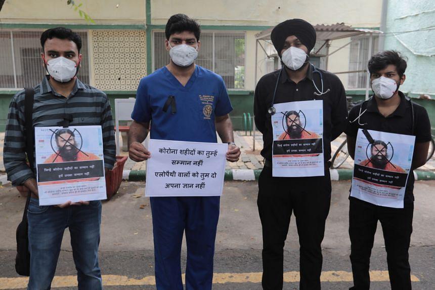 "Doctors take part in a ""Black Day"" protest, calling for the arrest of yoga guru Baba Ramdev in New Delhi on June 1, 2021."