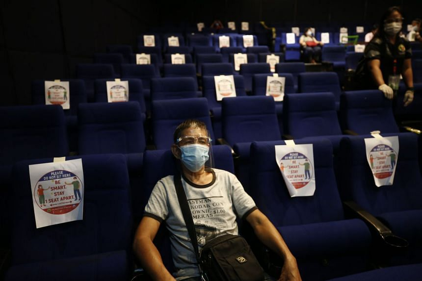 A man rests inside a cinema complex after being inoculated with the Sinovac Covid-19 vaccine in San Juan City, on June 1, 2021.