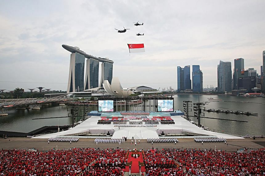 The state flag fly-past at the National Day Parade in 2018, which was the last time the parade was held at the Marina Bay floating platform. When ST visited the floating platform last week, a sign said maintenance was in progress from April 26 to Jul