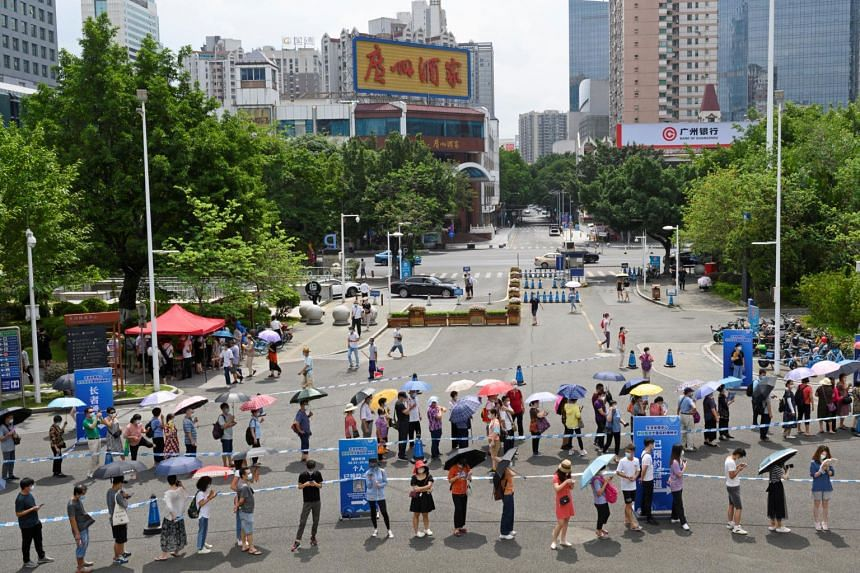 People lining up to receive a Covid-19 jab outside a vaccination site in Guangzhou, Guangdong province, on May 29, 2021.