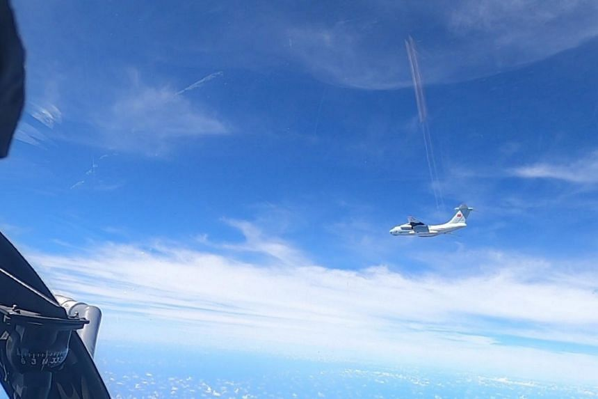 Malaysia says the Chinese planes did not respond to attempts to contact them.
