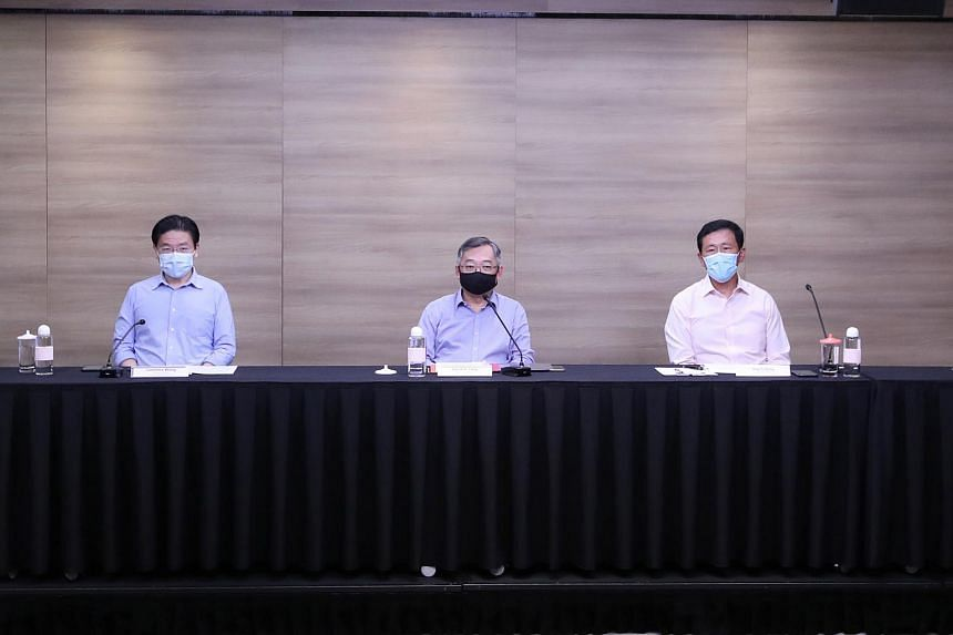 (From left) Finance Minister Lawrence Wong, Trade and Industry Minister Gan Kim Yong and Health Minister Ong Ye Kung at the MTF press conference on May 31, 2021.
