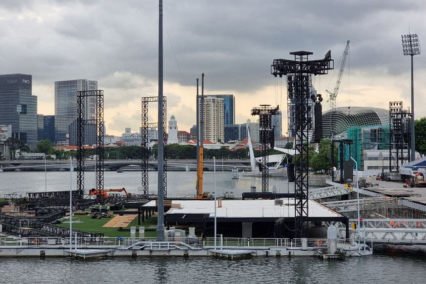 Installation work, on what appears to be a stage, being done on the floating platform at Marina Bay on May 27, 2021.