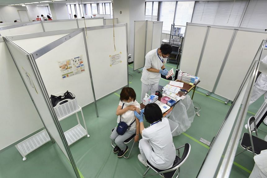 A senior citizen getting a Covid-19 vaccination shot at a large-scale inoculation centre in Osaka, Japan, on May 24, 2021.