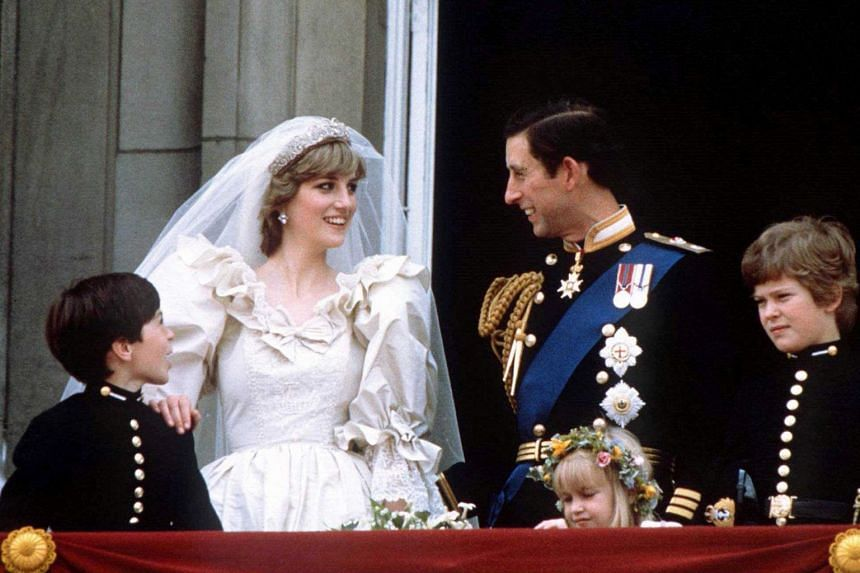Princess Diana and Prince Charles stand on the balcony of Buckingham Palace, following their wedding at St Paul's Cathedral, on June 29, 1981.