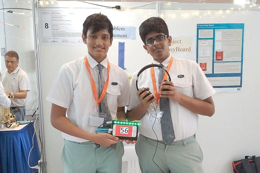 National Junior College students who created an app and smart glasses to convert what people are saying into text and project it onto the smart glasses for deaf people to read. From far left: Deenadayalan Amirthaa, Kabileswaran Krishna Kumar, Bharagt