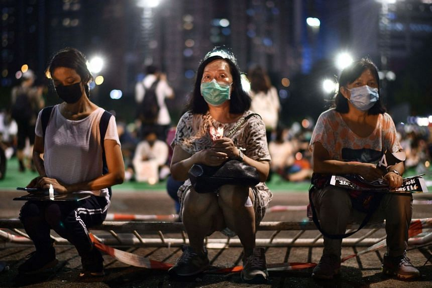Activists on June 4, 2020, holding a candlelit vigil in Hong Kong's Victoria Park to mark the 1989 Tiananmen Square crackdown.