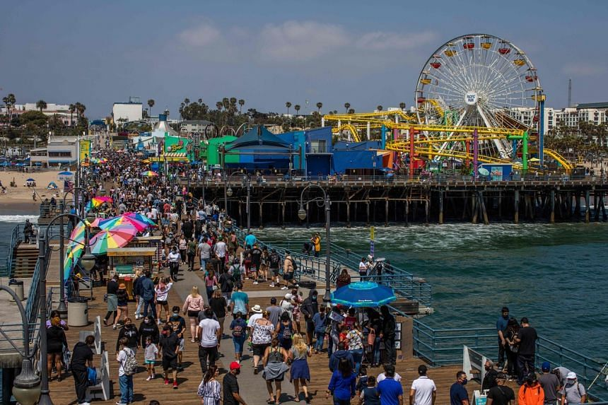 People at a pier in Santa Monica, California, on May 29, 2021. Countries with a sizeable domestic travel market are expected to see a rebound in tourism levels earlier.