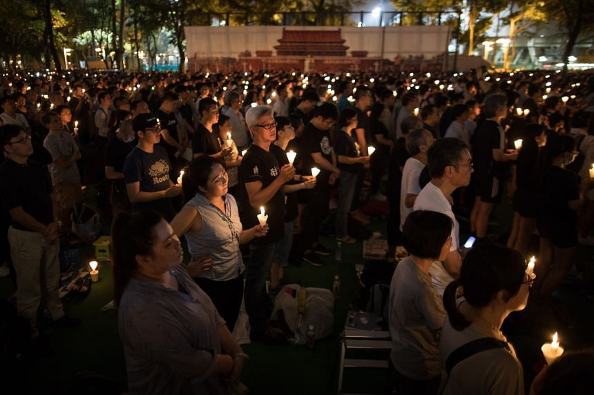 In this photo taken on June 4, 2019, participants attend the annual candlelit vigil commemorating the 30th anniversary of the 1989 Beijing Tiananmen Square massacre at Victoria Park in Hong Kong.