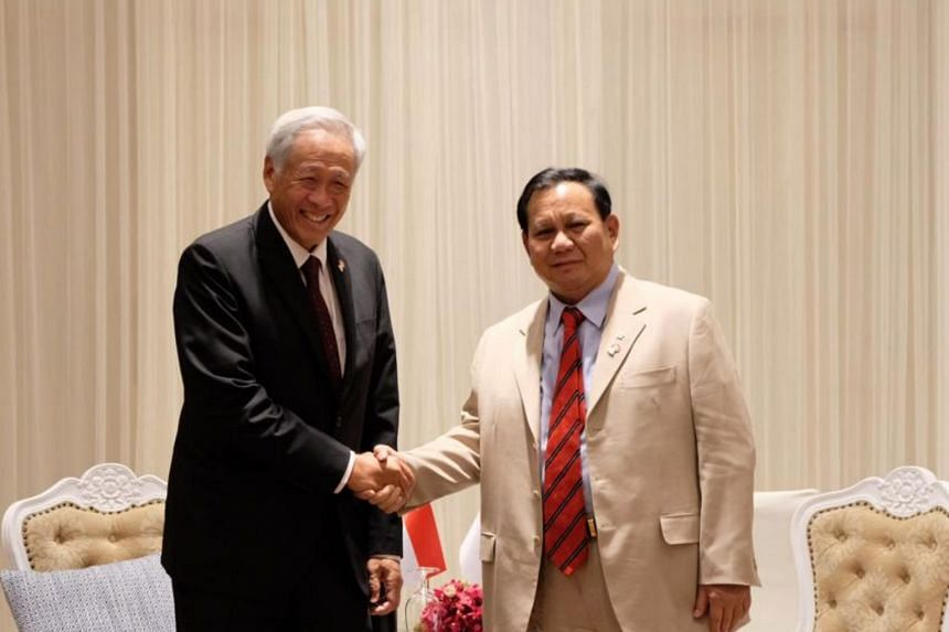 In this photo from November 2019, Defence Minister Ng Eng Hen (left) meets Indonesian Defence Minister Prabowo Subianto on the sidelines of the Asean Defence Ministers' Meeting Retreat in Bangkok.