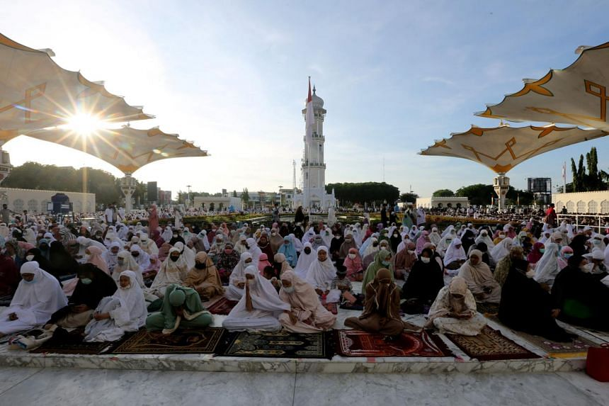 In this photo taken on May 13, 2021, Indonesian Muslims attend a mass prayer session at the Great Mosque of Baiturrahman in Aceh.