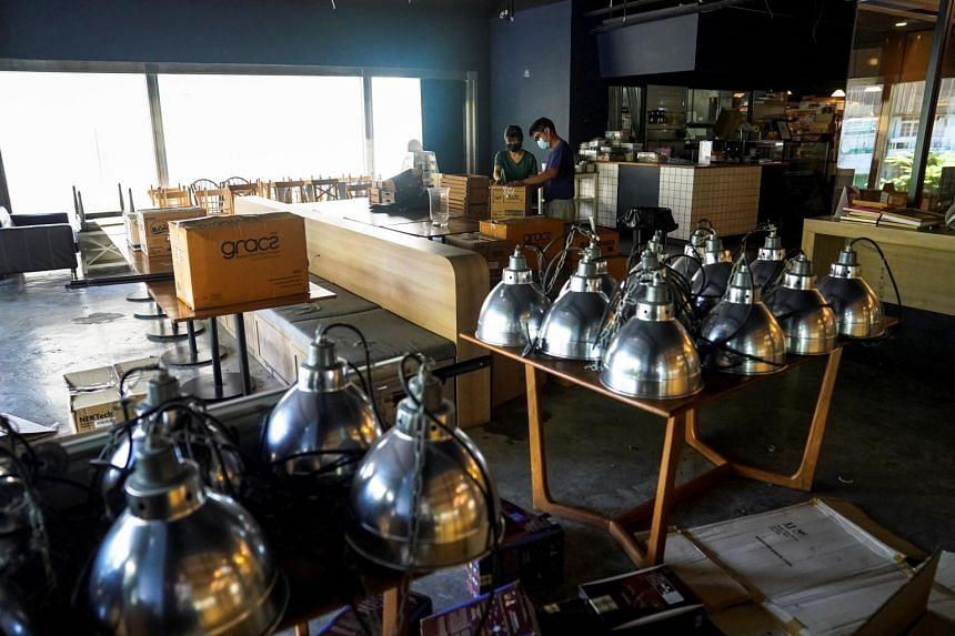 Staff packing up inside Chu Chocolate Bar & Cafe in Bangkok on May 31, 2021.