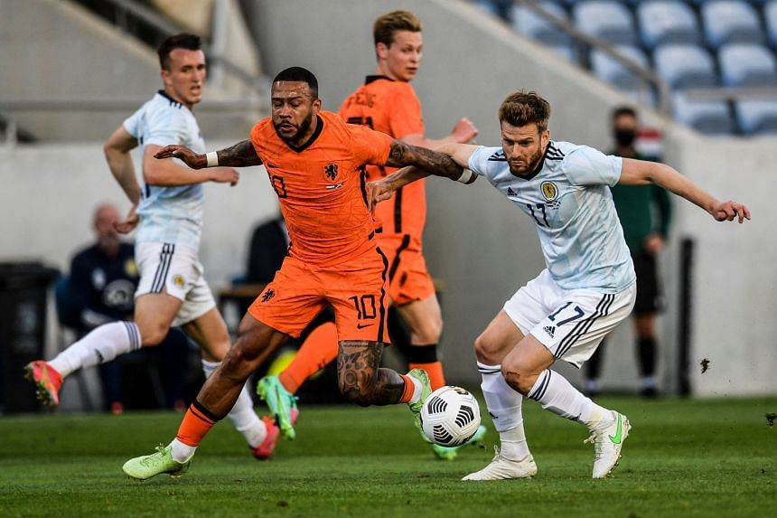Memphis Depay (left) vies with Scotland's forward Stuart Armstrong at the Algarve stadium in Faro, on June 2, 2021.