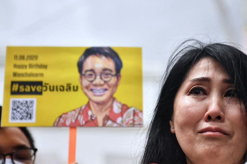 Ms Sitanan Satsaksit, sister of missing activist Wanchalearm Satsaksit, addresses the media in front of the Cambodian Embassy in Bangkok on Aug 11, 2020.