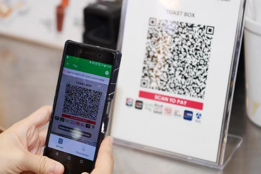 The introduction of Giro in 1984 was the Government's first foray into e-payments. Since then, initiatives such as the EZ-Link card, PayNow and the Singapore Quick Response Code (above) have been rolled out to promote cashless payments.