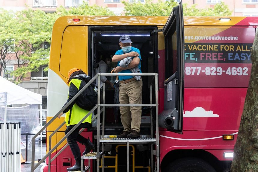 A man leaves a mobile vaccination clinic bus after getting his Covid-19 vaccine shot, near Brighton beach, New York, on May 29, 2021.