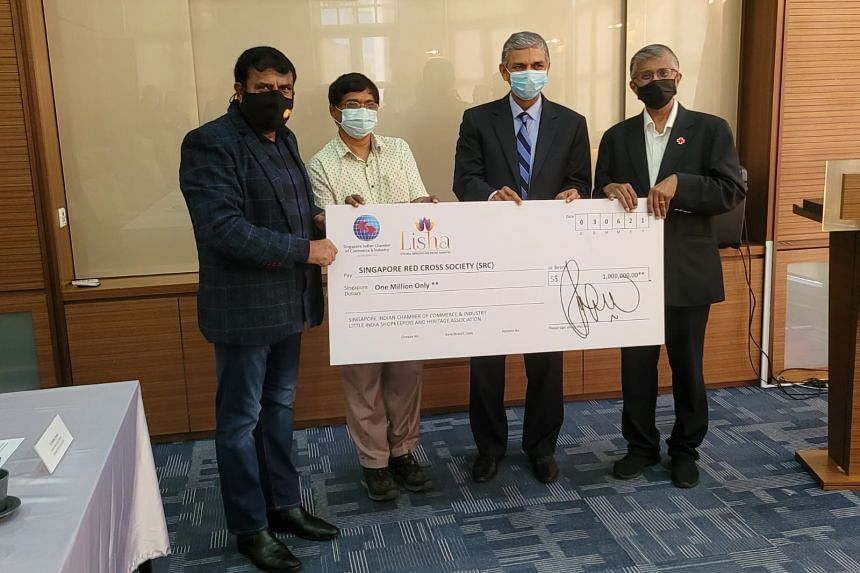 Cheque presentation of $1 million from the Singapore Indian Chamber of Commerce and Industry and the Little India Shopkeepers' Association to Singapore Red Cross, on June 3, 2021.