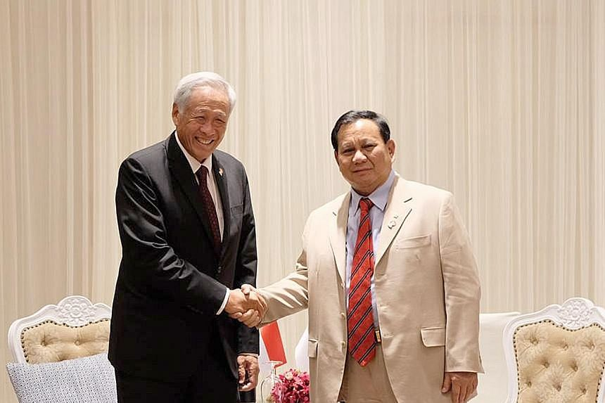 Singapore's Dr Ng Eng Hen and Indonesia's Mr Prabowo Subianto on the sidelines of the Asean Defence Ministers' Meeting in Bangkok in 2019. PHOTO: MINDEF