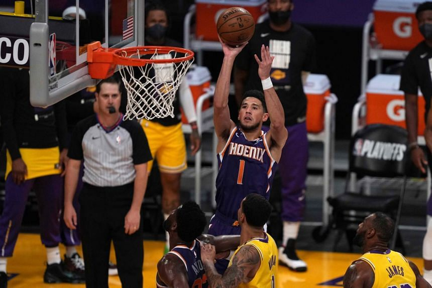 The second-seeded Phoenix Suns leaned on the inside-outside combination of Devin Booker (above) and Deandre Ayton.