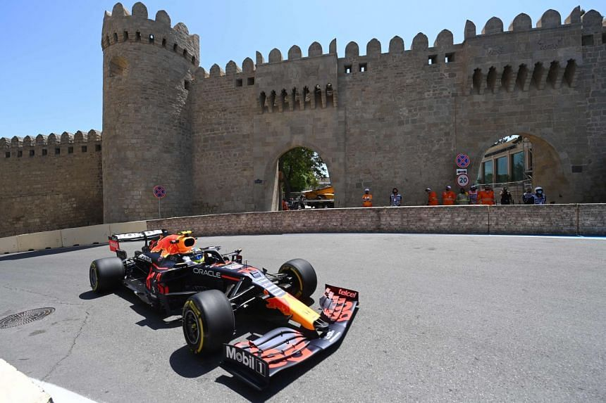 Red Bull's Mexican driver Sergio Perez steers his car during the first practice session in Baku.
