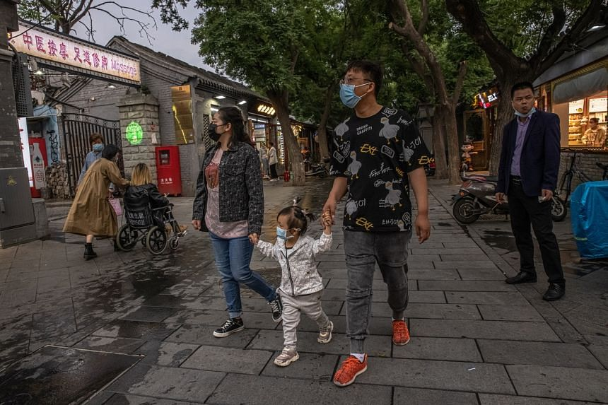 A family in Beijing. Education is seen by parents as a ticket to a better life, but it may be getting harder to stand out with a university degree in China. Record numbers have graduated even as the number of new urban jobs falls.