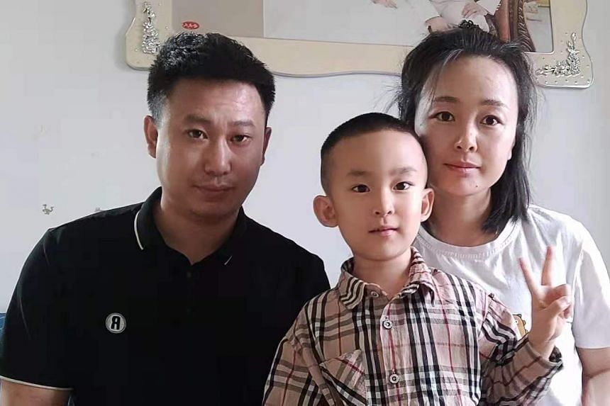 Ms Li Ji with her husband, Mr Lv Yue Feng, and their only child, five-year-old Lv Yi Ming. The couple are not planning to have another child despite the policy change, citing financial concerns.