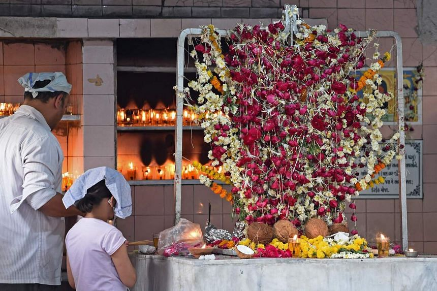 A photo taken on March 23 shows Parsis praying on the occasion of Ava Yazad Parabh in Ahmedabad, India.