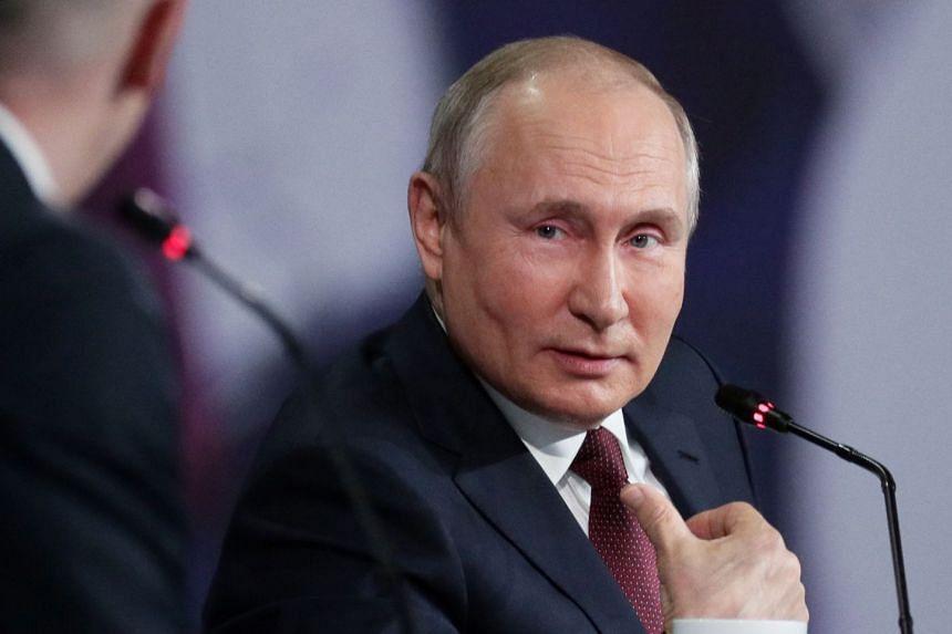 Russian President Vladimir Putin attends a session of the St. Petersburg International Economic Forum.