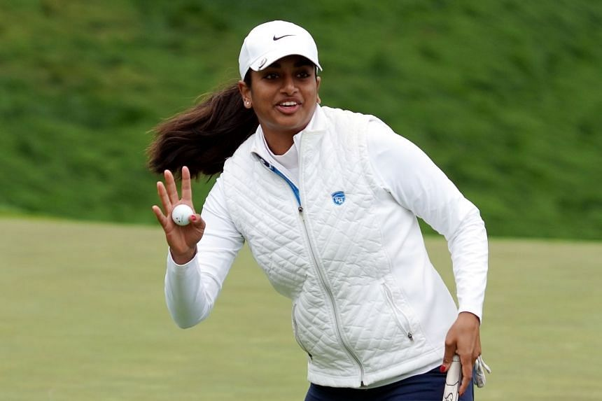 Megha Ganne waves after putting out on the eighth green during the second round.