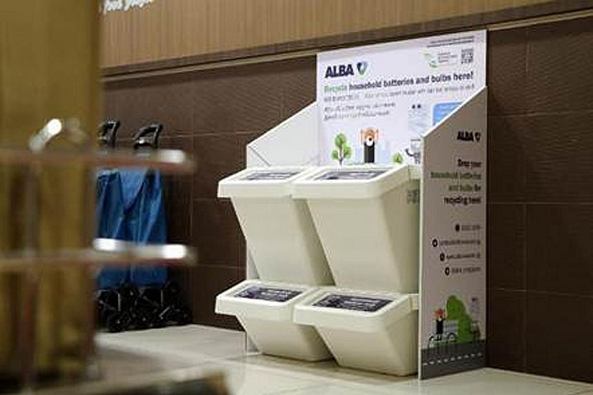 A bin at Harvey Norman Millenia Walk for recycling IT and computer equipment, batteries and light bulbs.