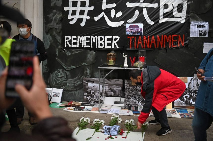 People leave flowers during a vigil outside the Chinese Embassy in London on June 4, 2021, to mark the 32nd anniversary of the 1989 Tiananmen Square crackdown in Beijing, China.