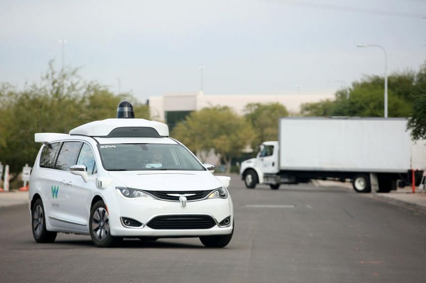 A 2018 photo of a Waymo Chrysler Pacifica Hybrid self-driving vehicle in Chandler, Arizona. Waymo is also building a new version of its self-driving technology that it will eventually deploy in other geographies and other kinds of vehicles, including