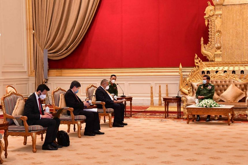 Asean Secretary-General Lim Jock Hoi (second from left) and Erywan Yusof, the second minister for foreign affairs for Asean chair Brunei  (third from left) and Myanmar's military ruler Min Aung Hlaing during a meeting in Naypyidaw, Myanmar, on June 4